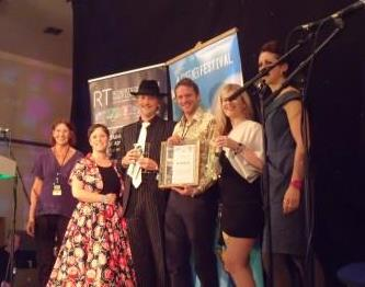 Shambala collect their 'outstanding' Award